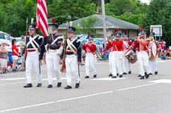 Military Reenactors at Mendota Parade. Mendota, Minnesota, USA – JULY 8, 2017: Fort Snelling military reenactors march through the historic city of Mendota Stock Photos