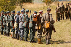 Military reenactors in uniforms of a World War II Royalty Free Stock Image