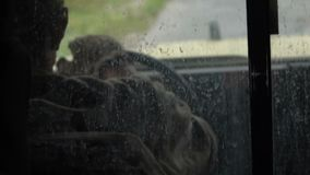 Military rides in a car. The military are driving in a car. View through the glass stock video