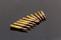 Military rifle bullets On a black background Royalty Free Stock Photo