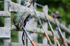 Military rifle and helmet Stock Image