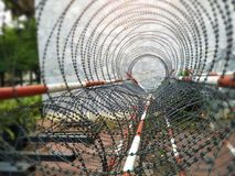 Military service area,close up barb wire fence and restricted area security. Illustration civil war with protest for demand for justice stock image