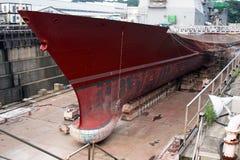 Military Ship in Drydock. In a Naval Shipyard stock photos