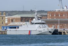 Military ship from the French navy a fisheries protection vessel. French navy vessel P676 Flamant. A search and rescue and fisheries patrol boat alongside in stock photography
