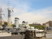 Military ship HMS Belfast anchored on river Thames Royalty Free Stock Images