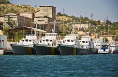 Military ship and yacht  in bay Royalty Free Stock Photography