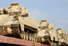 Military Shipment. A train loaded with a shipment of military tanks Royalty Free Stock Photo