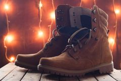 Military shoes, glowing garland, Royalty Free Stock Photo