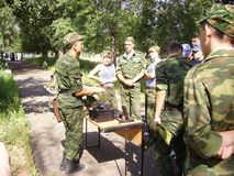 Military shows adolescents military equipment. Combat training of high school students in Russia. Teenagers in camouflage uniforms are preparing to defend stock images