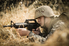 Military soldier aiming with a rifle Royalty Free Stock Images