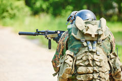 Military soldier with assault rifle patrolling Stock Photos
