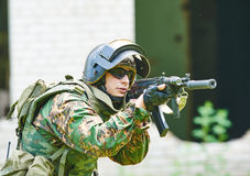 Military soldier with assault rifle patrolling Royalty Free Stock Image