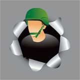Military soldier coming out of paper hole Stock Photo