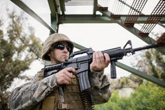 Military soldier guarding with a rifle. In boot camp stock photo