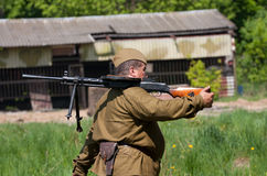 Military soldier holding soviet machine gun  Degtyaryov Royalty Free Stock Photos