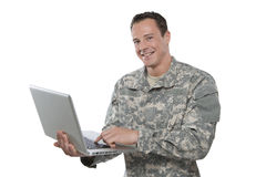 Military Soldier With A Laptop. A military man holds a laptop computer