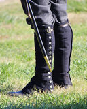 Military Soldier of the Past. 1800`s military soldier with saber, gaiters and boots Stock Image