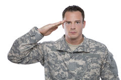 Military Soldier Salutes. A caucasian soldier in camouflage salutes stock image