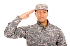 Military soldier saluting. Close up portrait of military soldier saluting royalty free stock images
