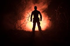 Military soldier silhouette with gun. War Concept. Military silhouettes fighting scene on war fog sky background, World War Soldie. R Silhouette Below Cloudy Royalty Free Stock Photo