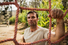 Military soldier standing near fitness trial Stock Images