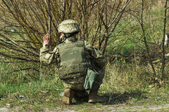 Military soldier at tactical exercises give a sign royalty free stock images
