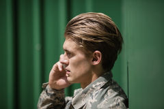 Military soldier talking on mobile phone Stock Image