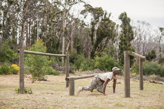 Military soldier training on fitness trail. At boot camp stock image