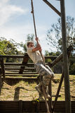 Military soldier training rope climbing Royalty Free Stock Photos