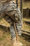 Military soldier training rope climbing Stock Photos