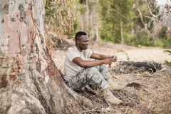 Military soldier using mobile phone during obstacle training. At boot camp Stock Photos