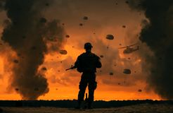 Military soldier watching helicopters and forces in battlefield stock images