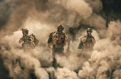 Military between fire and smoke in destroyed house stock photos
