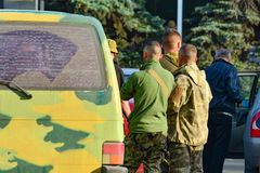 Military soldiers inspect civilian cars to prevent terrorist attacks.  royalty free stock image