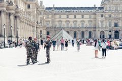 Military soldiers at Louvre. PARIS, FRANCE - JUNE 29, 2015 : Louvre museum yard with military soldiers for safety Royalty Free Stock Images