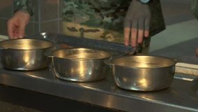 Military soldiers receive food in the dining room. Buckwheat porridge with meat sauce in a soldier`s canteen, Military soldiers receive food in the dining room stock video footage