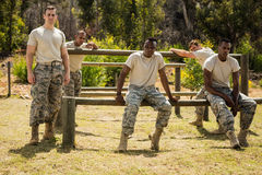Military soldiers relaxing on fitness trail Stock Photos