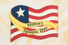 Military Spouse Day message with retro wood American flag. With a yellow ribbon stock photos