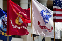 Military Standards. Standards of three of the US Military services on parade and waving in the Central Florida afternoon royalty free stock photo
