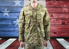 Military standing against american flag. Digital composite of Military standing against american flag Stock Image