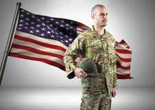 Military standing against american flag. Digital composite of military standing against american flag Royalty Free Stock Image
