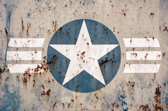 Military army star insignia background. White and blue army star symbol on corroded metal plate texture background with peeling paint Stock Photo