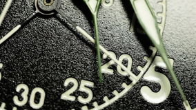 Military stopwatch clock face close up. Military stopwatch close up of the hands on the clockwork clock face with selective focus stock footage