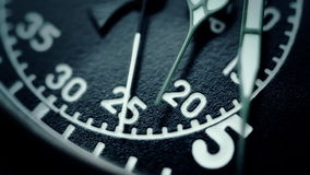 Military stopwatch clock face close up. Military stopwatch close up of the hands on the clockwork clock face with selective focus stock video footage