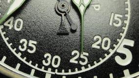 Military stopwatch clock face close up. Military stopwatch close up of the hands on the clockwork clock face with selective focus stock video