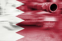 Military strength theme, motion blur tank with Bahrain flag Royalty Free Stock Photography