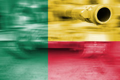 Military strength theme, motion blur tank with Benin flag Royalty Free Stock Photography