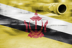 Military strength theme, motion blur tank with Brunei Darussalam Stock Photography