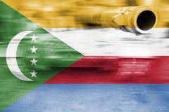 Military strength theme, motion blur tank with Comoros flag Stock Photos