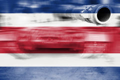 Military strength theme, motion blur tank with Costa Rica flag Stock Photo